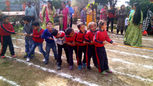 Children busy in tug of war while celebrating Toon Olympics at Euro Care in Jammu.