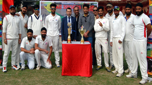 Jubilant Market Bulls Cricket Club players posing for a group photograph alongwith chief guest, Farooq Ahmed Shah, Secretary Tourism and other dignitaries on Friday.