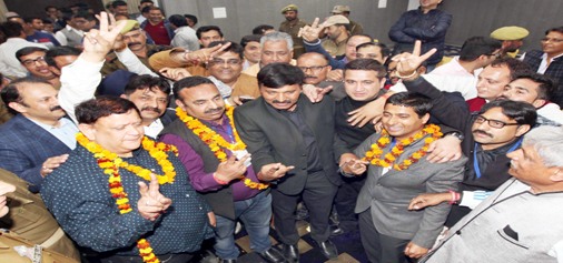 Re-elected Jammu Chamber president, Rakesh Gupta with his winning team after election results were declared at mid-night on Sunday. —Excelsior/Rakesh