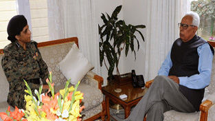 Governor NN Vohra interacting with DIG CRPF Nitu Bhattacharya in Jammu on Wednesday.