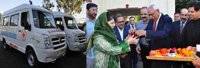 Governor N N Vohra handing over ambulance keys to Chief Minister Mehbooba Mufti on Friday.