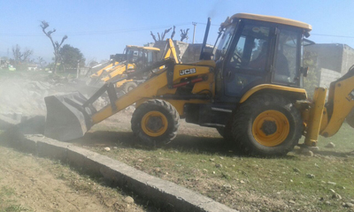 JCB of JDA removing encroachment in Majeen Sidhra on Saturday.