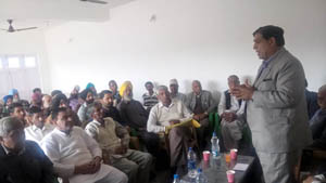 PCC leader Ravinder Sharma addressing a public meeting at Nowshera on Thursday.
