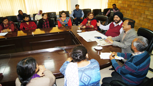 JMC Commissioner Manmohan Singh and Joint Commis-sioner (A) R S Jamwal during a meeting at Jammu on Wednesday.