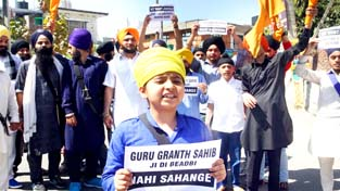 Sikh youth protesting against sacrilegious act at Nanak Nagar in Jammu on  Sunday.