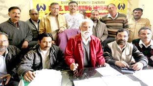 PHE Workers Welfare Association president, Bakshi Singh addressing press conference in Jammu on Wednesday. -Excelsior/ Rakesh