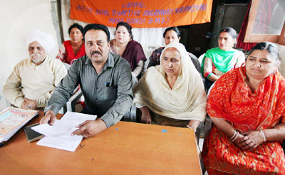 BMS leaders addressing press conference at Jammu on Saturday. -Excelsior/ Rakesh