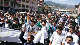 Students of Bhaderwah College taking out protest march against JU on Monday.
