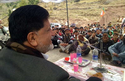Minister for Animal, Sheep Husbandry and Fisheries A G Kohli addressing a gathering in Rajouri on Wednesday.