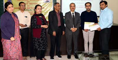 Poster presentation awards being given during valedictory function of a seminar in JU on Saturday.