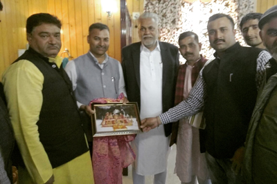 Sanskrit Scholars presenting portrait of Mata Vaishno Devi to Union Minister of State for Agriculture at Srinagar on Saturday.