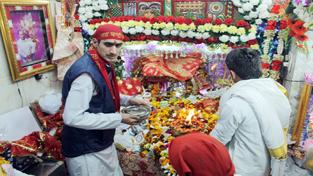 Priests decorating Chandi Mata temple at Pacca Danga in Jammu on Wednesday.