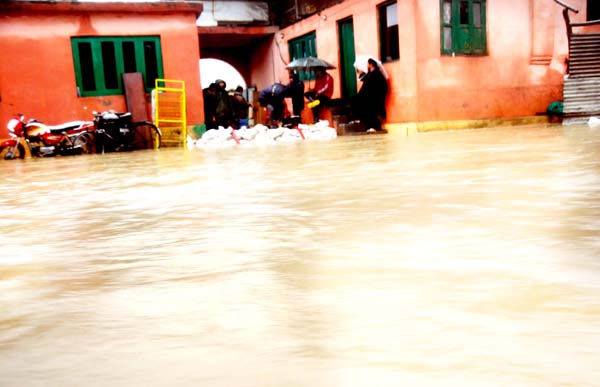 Water entered into the houses at Bemina in Srinagar on Thursday. (UNI)