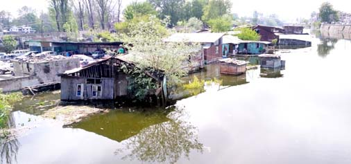 A view of inundated houses on Choant Kul (river) bank in Srinagar after increase in water level of Dal lake and river Jhelum. -Excelsior/Shakeel
