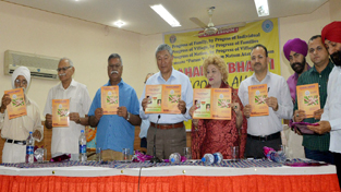 Minister for Co-operatives and Ladakh Affairs Chering Dorjay releasing NGO's book 'Sahakar Sandesh' at a function held on Sunday.