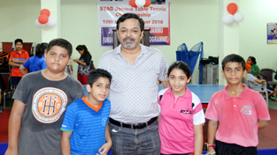 Winners posing for a group photograph along with former ace peddler at Stag TT Academy in Jammu on Sunday.