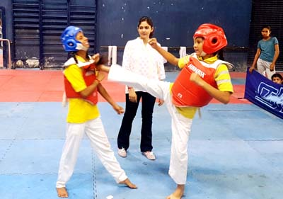 Players in action during Inter School Martial Art competitions at Indore Complex MA Stadium in Jammu on Saturday.