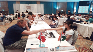 Ace Chess player Meenal Gupta displaying skill at International Open Chess event in Thailand.