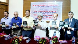 Speaker Kavinder Gupta, MLC Ashok Khajuria and other dignitaries releasing a book at Press Club Jammu on Saturday. -Excelsior/ Rakesh