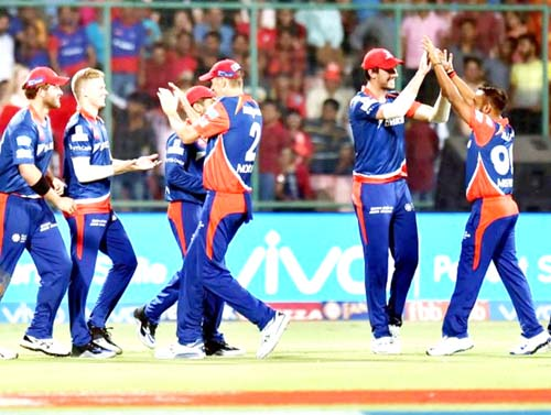 Delhi Daredevils players celebrating dismissal of Glenn Maxwell at Ferozshah Kotla in New Delhi on Saturday.