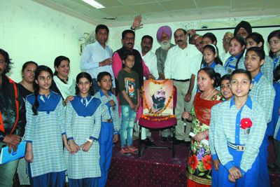 Students and members of JKFFA paying tributes to General Zorawar Singh on Wednesday.