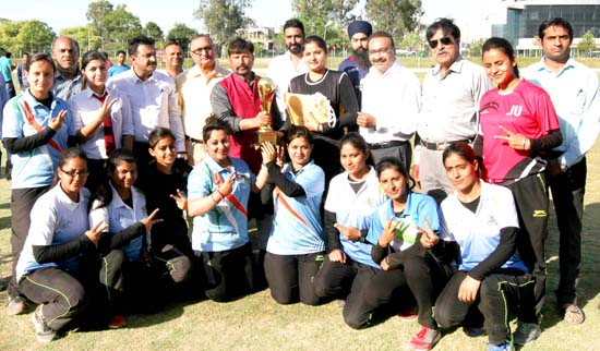Winners posing along with chief guest, Ch Lal Singh and other dignitaries at Jammu University on Saturday. -Excelsior/Rakesh