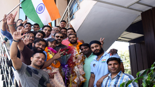 Medal winning Wushu players being accorded rousing reception in Jammu after returning from Yerevan in Armania.