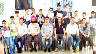 Winners of Chess events posing for a group photograph along with office bearers and officials in Jammu on Thursday.