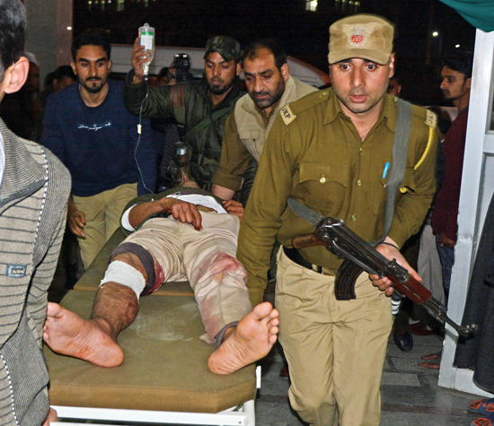Policeman injured in Nowhatta militant attack being shifted to SMHS Hospital for treatment. — Excelsior/Shakeel