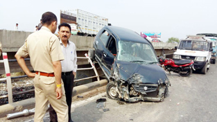 A car which was totally damaged in an accident at Sahar bridge on Saturday.