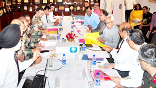 Governor N N Vohra chairing Rajya Sainik Board meeting in Jammu on Monday.