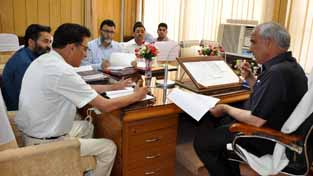 Minister for Revenue A R Veeri chairing a meeting in Jammu on Thursday.