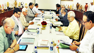 Governor N N Vohra chairing University Council meeting of Kashmir University.
