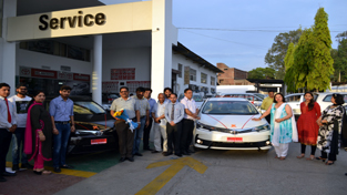 Officials of Shree Toyota delivering the first batch of 'The New Corolla Altis' to the customers.