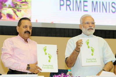 Prime Minister Narendra Modi with Minister of State for Development of North Eastern Region (I/C), Prime Minister's Office, Personnel, Public Grievances & Pensions, Atomic Energy and Space Jitendra Singh releasing a publication at the 11th Civil Services Day function, in New Delhi on Friday. (UNI)