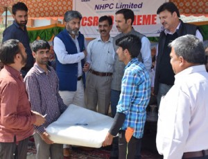 Kishanganga Project of NHPC  distributes aid to nearby villages