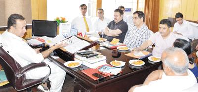 Minister for FCS&CA Choudhary Zulfkar Ali chairing a meeting in Jammu on Thursday.