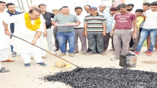 Minister for Industries and Commerce, Chander Parkash Ganga inaugurating black-topping work at Vijaypur on Sunday.