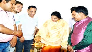 Education Minister, Priya Sethi lighting a traditional lamp to inaugurate a seminar in Poonch on Sunday.