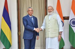 Prime Minister Narendra Modi meeting Prime Minister of the Republic of Mauritius Pravind Kumar Jugnauth, at Hyderabad House, in New Delhi on Saturday. (UNI)