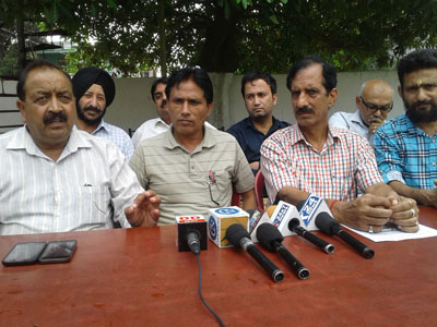 The office bearers of All J&K Employees Association interacting with media persons at Kathua on Thursday. -Excelsior/Pardeep