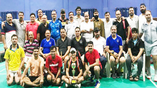 Winners of Badminton League posing along with chief guest, Gulzar Singh Salathia, retired IGP and others dignitaries in Jammu on Sunday.