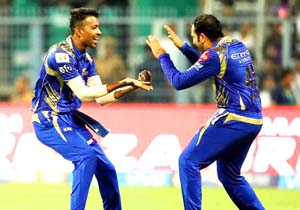 Hardik Pandya celebrating the wicket of Manish Pandey with Rohit Sharma at Eden Gardens on Saturday.