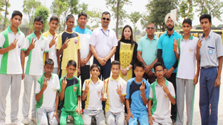 Jubilant winners of Inter-School Under-17 boys Kho-Kho Tournament posing for a group photograph along with officers and officials in Samba.
