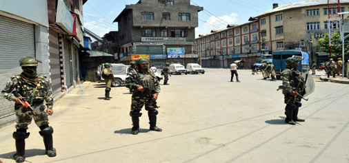 Security personnel patrol a Srinagar locality on Sunday. —Excelsior/Shakeel