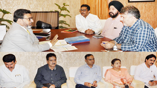 Minister for Education Altaf Bukhari chairing a meeting at Srinagar on Monday.