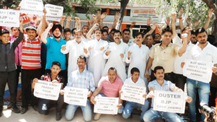NPP activists staging protest in Jammu on Monday.