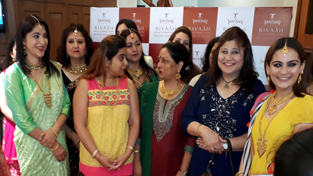 Staff of Tanishq store, Jammu during the launch of 'Rivaah Collection.'