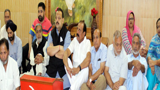 NC Provincial President Devender Singh Rana and others during a convention in Jammu on Tuesday.