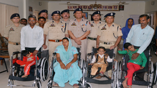 Physically challenged persons posing for a photograph after receiving wheel chairs on Thursday.